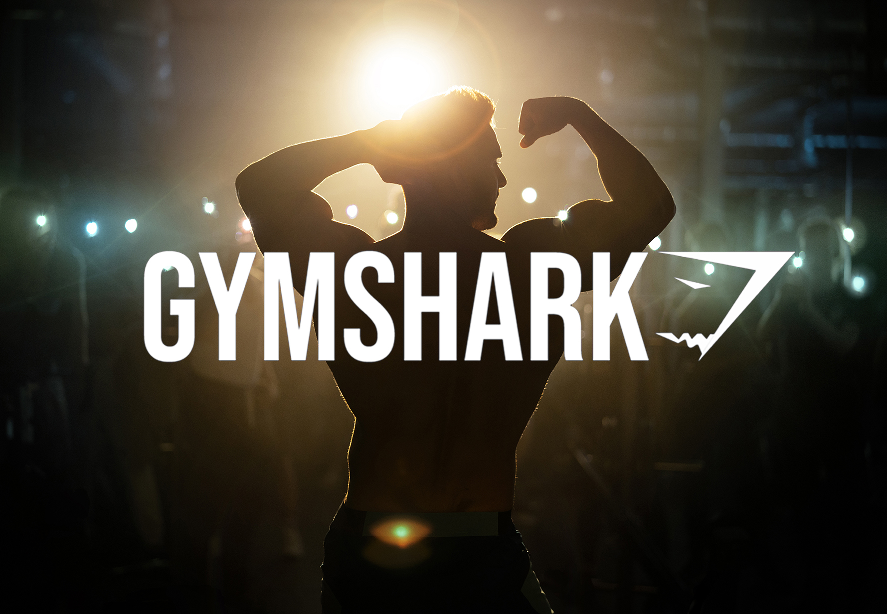 Gymshark advertising photographer image - model posing with logo